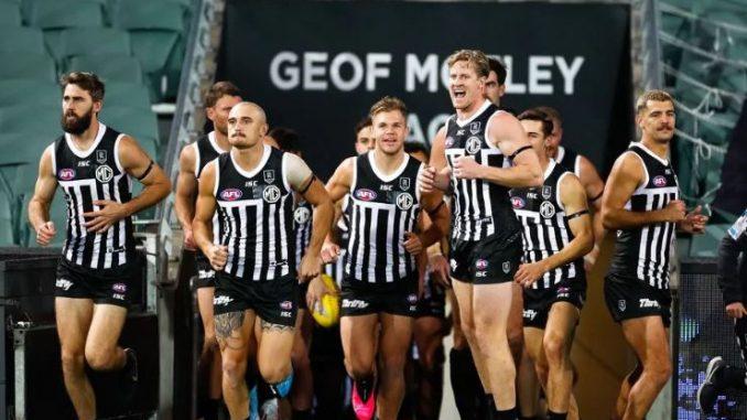 Port Adelaide wearing Prison bar guernseys