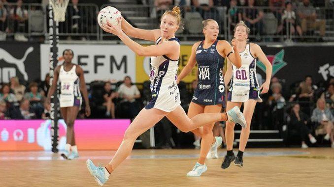 McAuliffe takes the ball ahead of Hannah Mundy